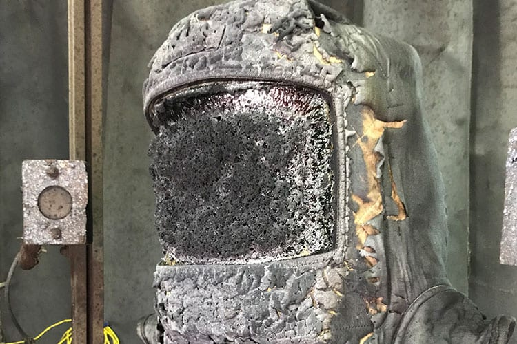PPE hood that has been damaged by arc-flash