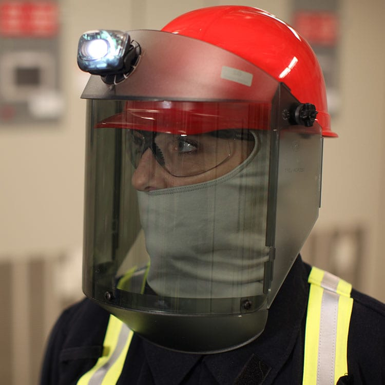 portrait of worker wearing PPE face shield