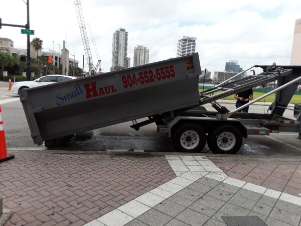 Dumpster being dropped off