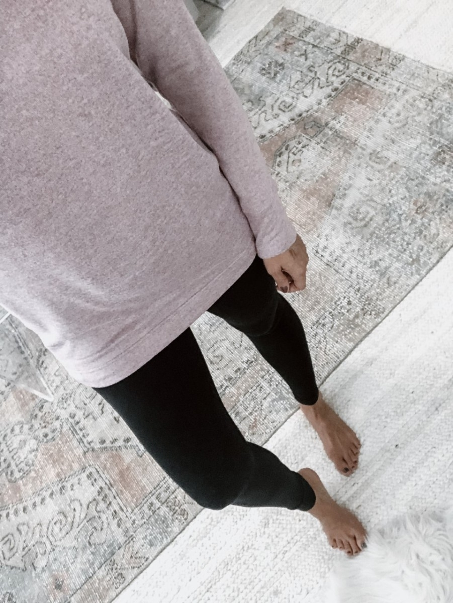black leggings | 5 Best Amazon Leggings Reviewed And Rated by popular Houston fashion blog, Haute and Humid: image of a woman wearing Amazon Fengbay High Waist Yoga Pants, Pocket Yoga Pants Tummy Control Workout Running 4 Way Stretch Yoga Leggings and Old Navy Sweater-Knit Mock-Neck Tunic Sweatshirt for Women.