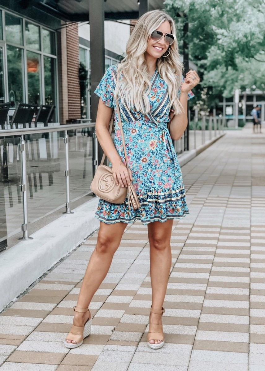 spring dress | Spring Skin Care by popular Houston beauty blog, Haute and Humid: image of a woman standing outside and wearing a Amazon ZESICA Women's Summer Wrap V Neck Bohemian Floral Print Ruffle Swing A Line Beach Mini Dress, Nordstrom Disco Leather Bag GUCCI, and Nordstrom Poppy Espadrille Wedge Sandal TREASURE & BOND.