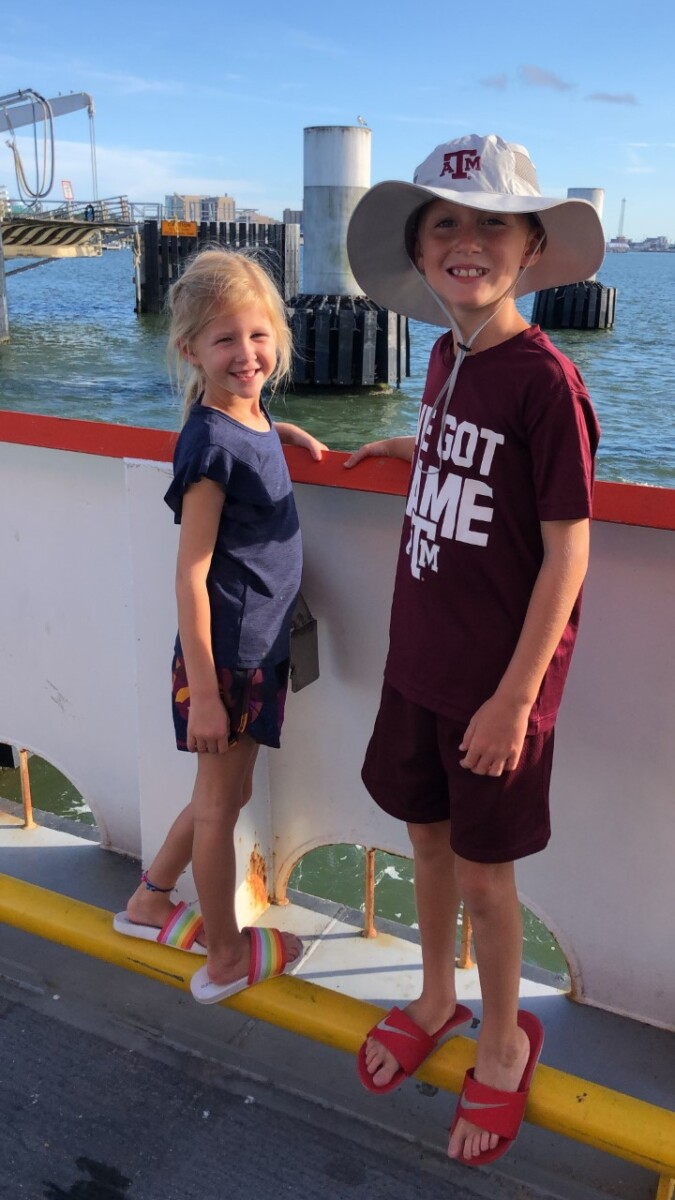 galveston travel guide | Galveston Travel Guide by popular Houston travel blog, Haute and Humid: image of two kids on the Galveston ferry.