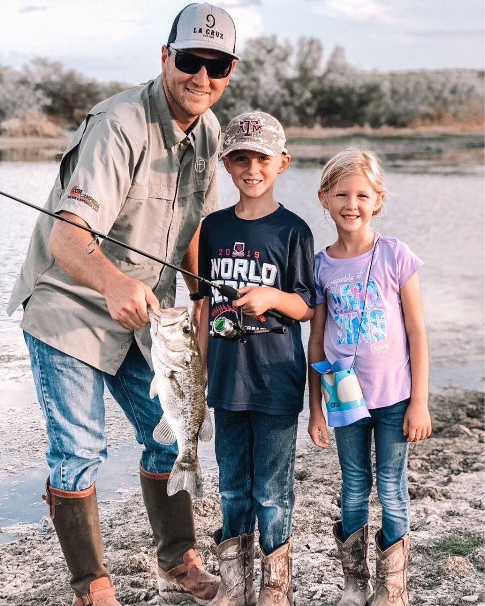 fathers day gifts | Father' Day Gift Ideas by popular Houston lifestyle blog, Haute and Humid: image of a man standing next to his two kids and holding a large fish.