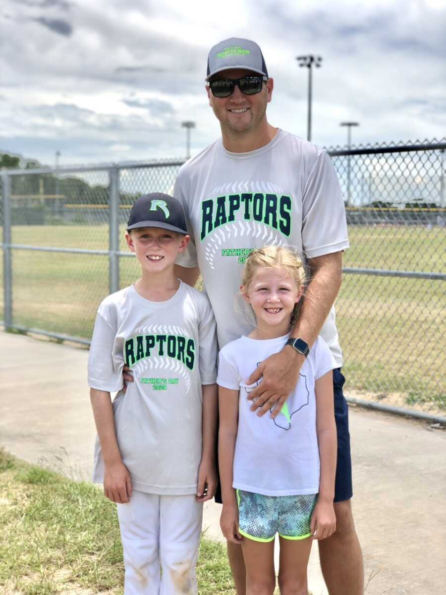 father's day gift guide | Father' Day Gift Ideas by popular Houston lifestyle blog, Haute and Humid: image of a dad standing with his son and daughter on a baseball field and wearing Raptors baseball t-shirts.