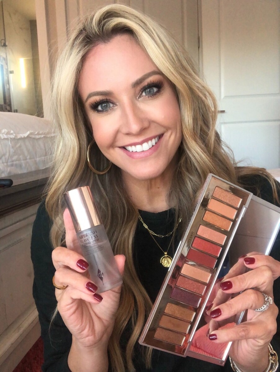 holiday makeup |Nordstrom Beauty by popular Houston beauty blog, Haute and Humid: image of a woman holding some Charlotte Tilbury setting spray and eyeshadow palette.