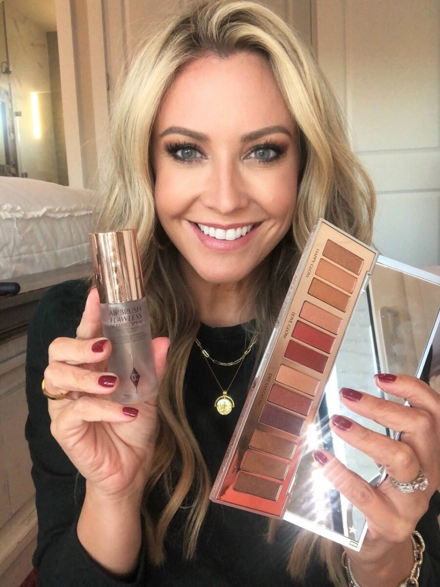 nordstrom makeup |Nordstrom Beauty by popular Houston beauty blog, Haute and Humid: image of a woman holding some Charlotte Tilbury setting spray and eyeshadow palette.