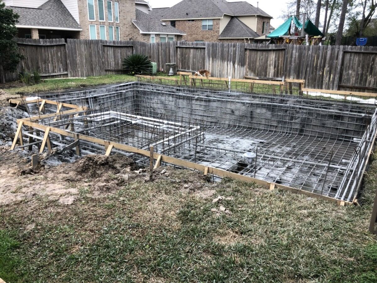 gunnite   pool dig   pool before and after   Outdoor Kitchen by popular Houston life and style blog, Haute and Humid: image of people building a pool.