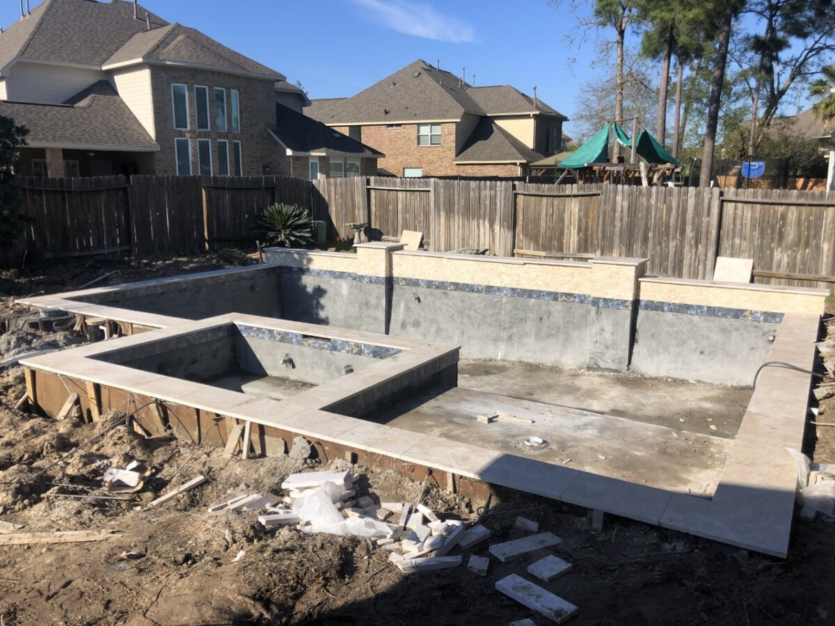 Pool and Outdoor Kitchen Design   pool dig   pool before and after   Outdoor Kitchen by popular Houston life and style blog, Haute and Humid: image of people building a pool in the backyard.