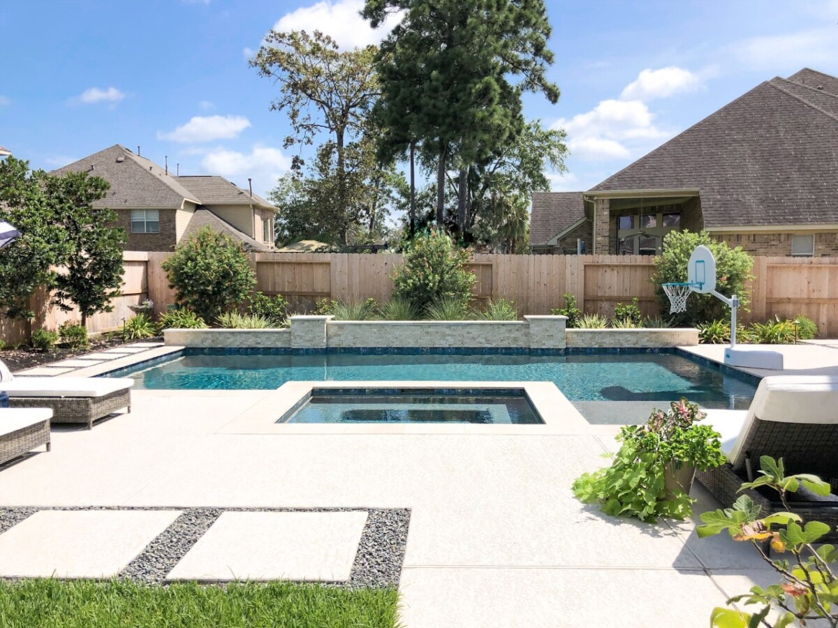 rectangular pool.   pool dig   pool before and after   Outdoor Kitchen by popular Houston life and style blog, Haute and Humid: image of a rectangle pool with a hot tub and basketball hoop.