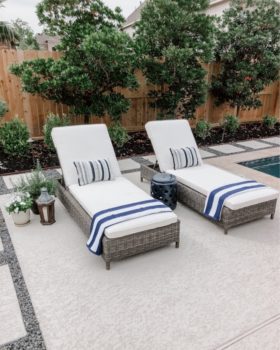 pool chaise lounge   Outdoor Kitchen by popular Houston life and style blog, Haute and Humid: image of two chaise lounge chairs with cream cushions and blue and white stripe towels.