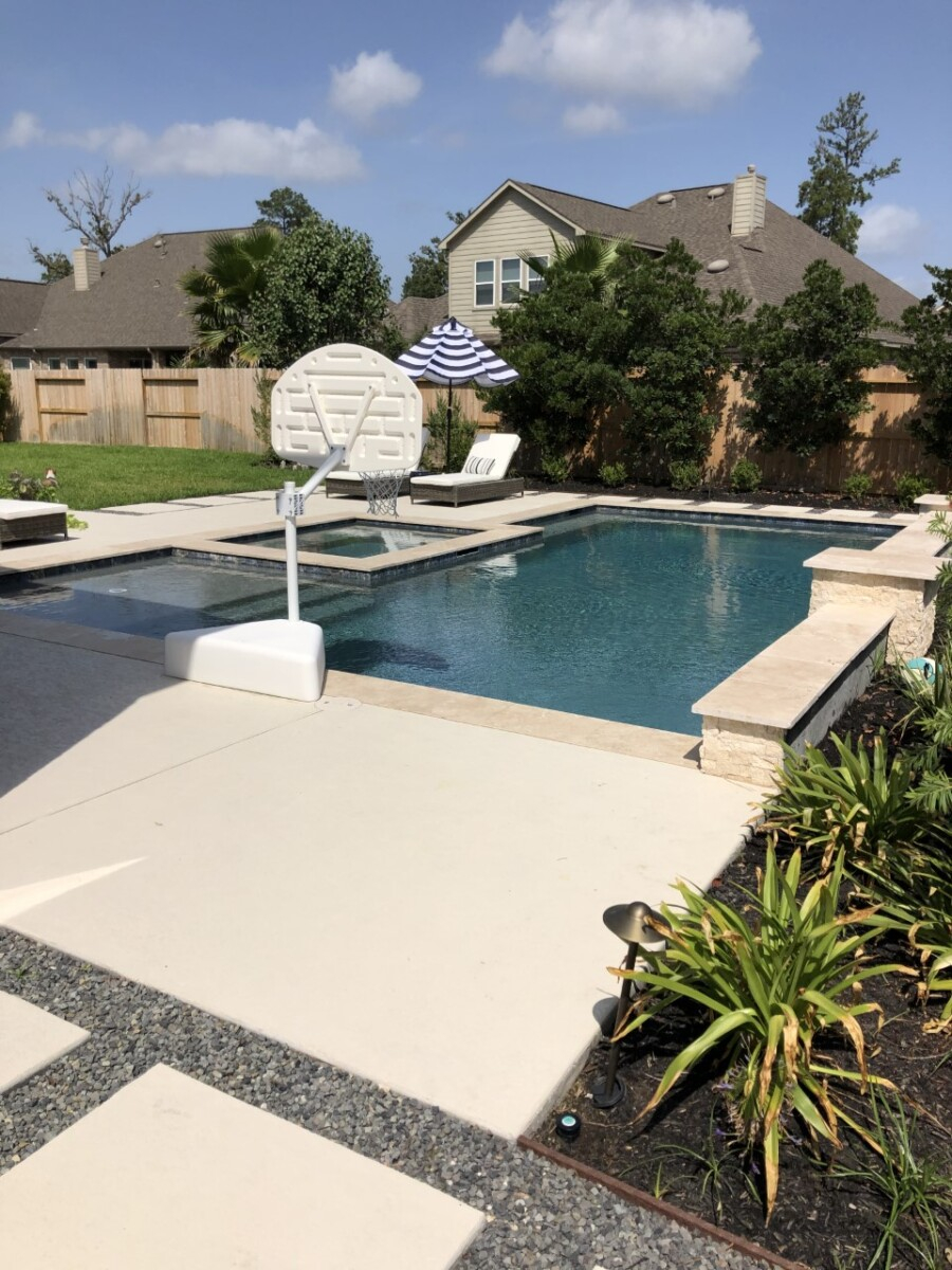 pool design   Outdoor Kitchen by popular Houston life and style blog, Haute and Humid: image of a rectangle pool with a hot tub and basketball hoop.