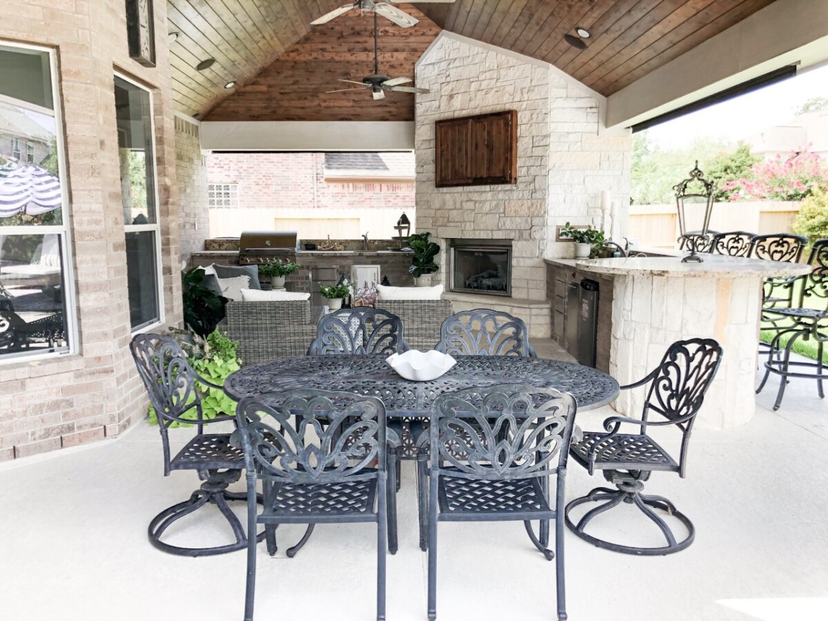 outdoor kitchen   Outdoor Kitchen by popular Houston life and style blog, Haute and Humid: image of a black outdoor table and chairs.