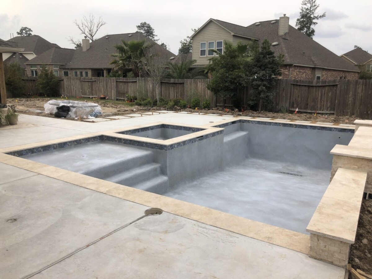 pool decking   pool dig   pool before and after   Outdoor Kitchen by popular Houston life and style blog, Haute and Humid: image of pool decking.