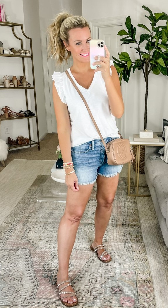 white tee | Amazon Prime Day by popular Houston fashion blog, Haute and Humid: image of a woman wearing a white v-neck flutter sleeve t-shirt with a pair of cutoff denim shorts, rhinestone strap slide on sandals, and a Gucci camera bag.