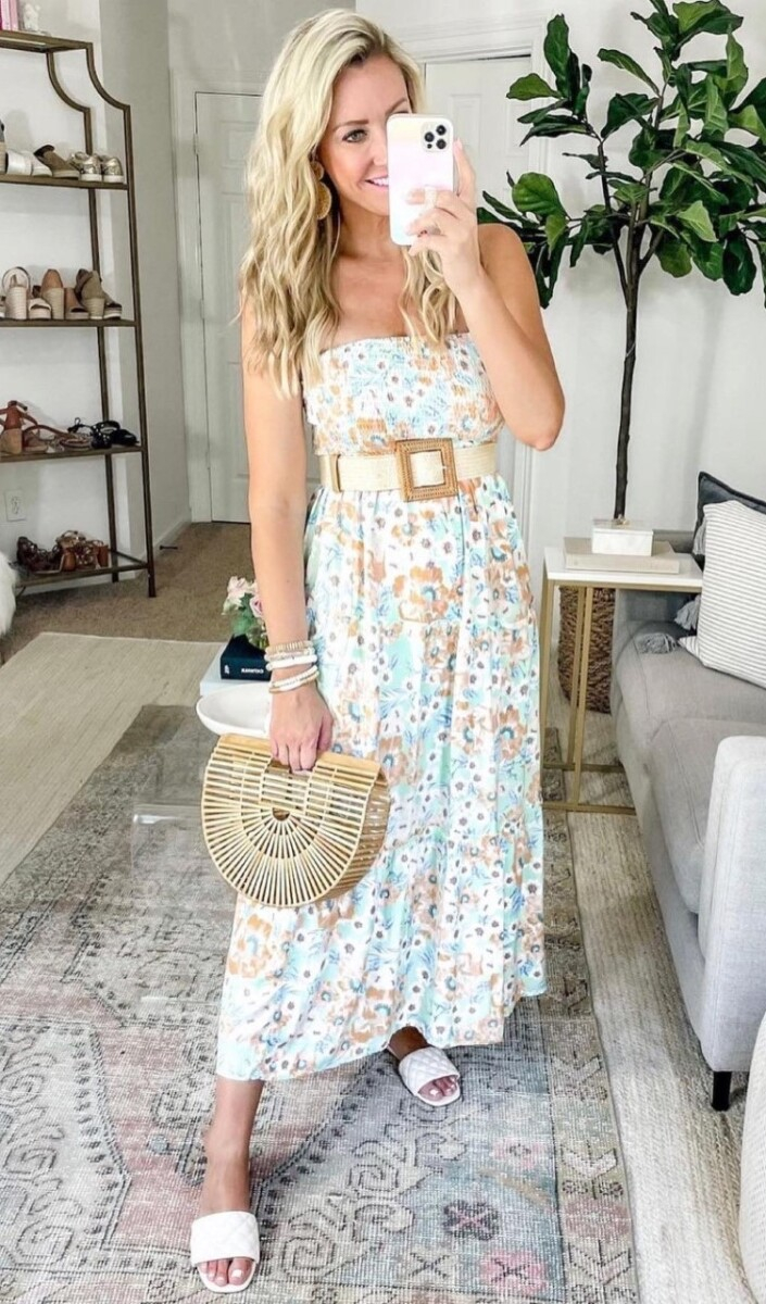 amazon prime maxi dress | Amazon Prime Day by popular Houston fashion blog, Haute and Humid: image of a woman wearing a blue and brown floral print strapless maxi Dres, cream waist belt, white strap slide sandals, and holding a bamboo handbag.