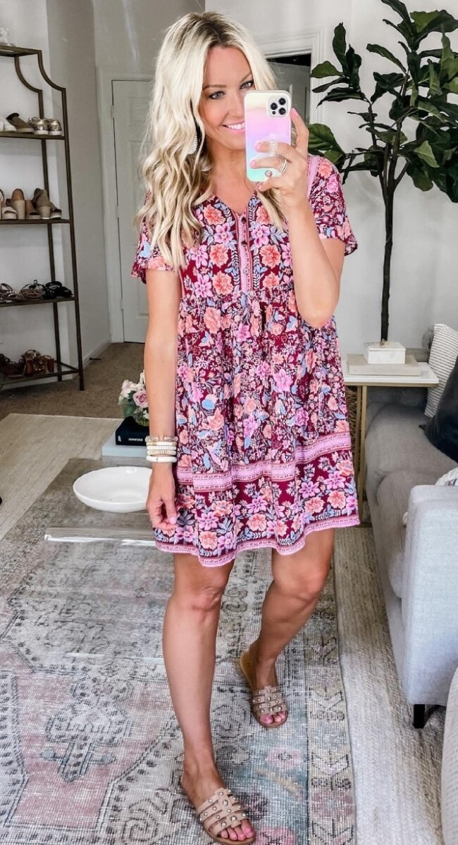 amazon prime dress | Amazon Prime Day by popular Houston fashion blog, Haute and Humid: image of a woman wearing a red and pink floral print mini dress, tan sliver studded slide sandals and white bead bracelets.
