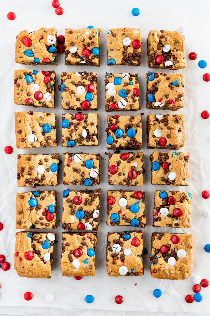 m&m cookie bars | 4th of July Desserts by popular Houston lifestyle blog, Haute and Humid: image of red white and blue M&Ms cookie bars.