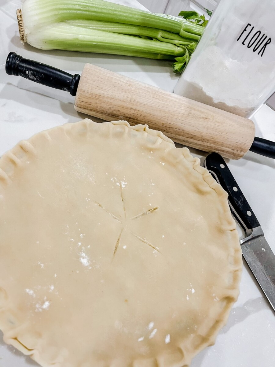 Meal Planning Tips by popular Houston lifestyle blog, Haute and Humid: image of a chicken pot pie next to a wooden rolling pin.