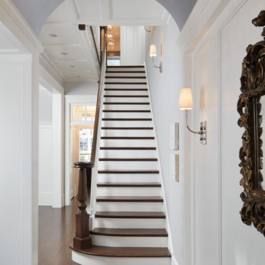 chicago custom home entryway with wooden staircase