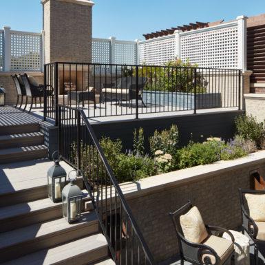 raised backyard patio wood burning fireplace metal railing