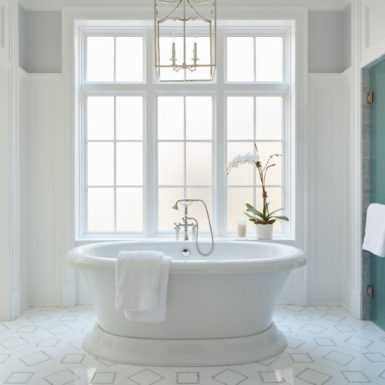 chicago luxury bathroom with chandelier and freestanding tub
