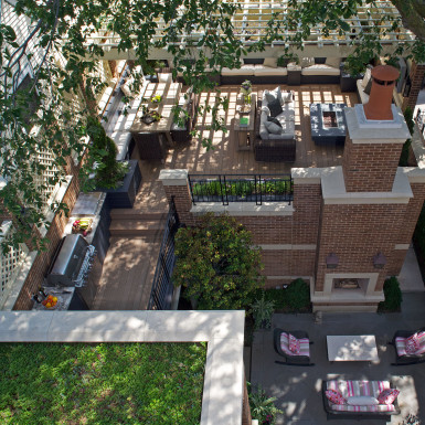 chicago luxury home courtyard with outdoor fireplace