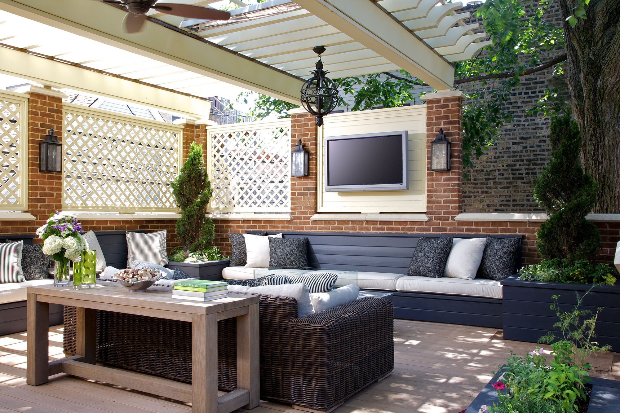 chicago luxury home outdoor living area with tv and couches