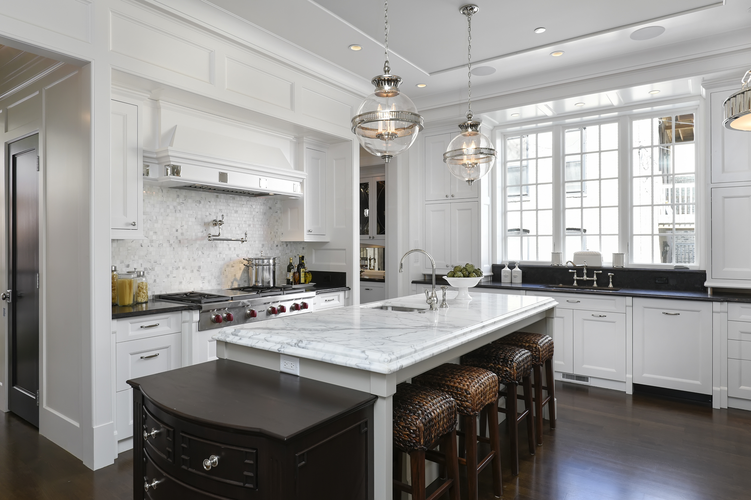 white kitchen in chicago with marble countertops