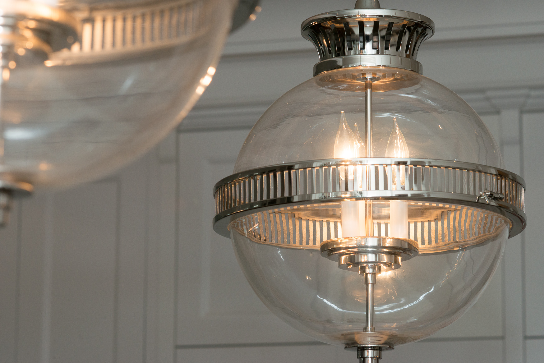 glass globe visual comfort light fixture in chicago luxury home