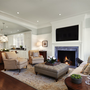 living room with fireplace large cased opening