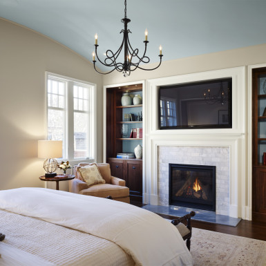 master bedroom with chandelier and gas fireplace chicago home staging