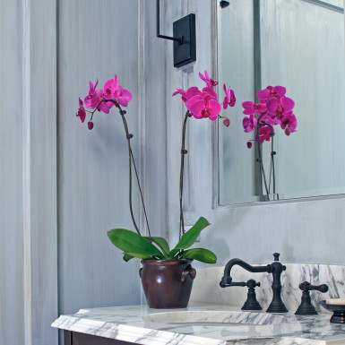 pink orchid in bathroom home staging