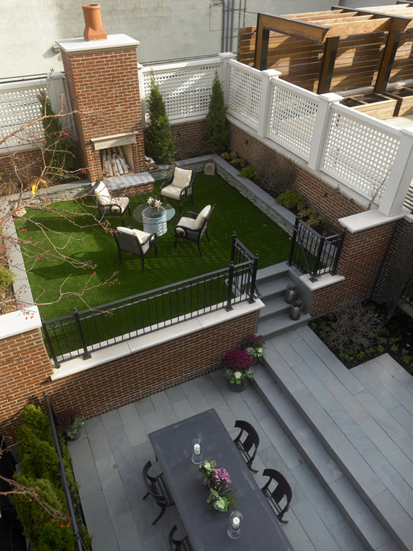chicago home backyard with outdoor fireplace and landscaping