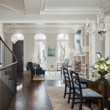 luxury chicago home dining room with chandelier and grand staircase