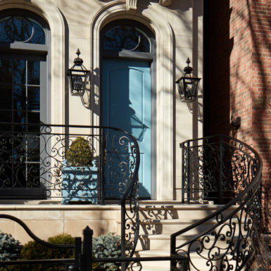 chicago home blue front door stone exterior with custom railing