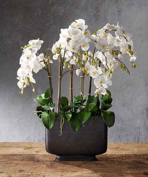 Faux Orchids in Bronze Vase