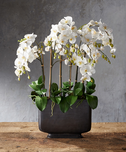 Faux Orchids in Bronze Vase