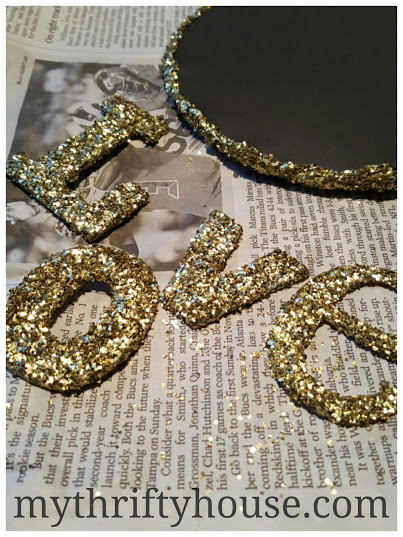 Glittered letters for vintage book page wreath