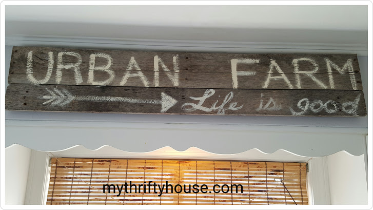 Creating a modern farmhouse kitchen using weathered wood and signs