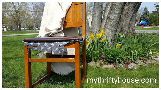 Before picture of salvaged chair reupholstered with drop cloth and stenciled