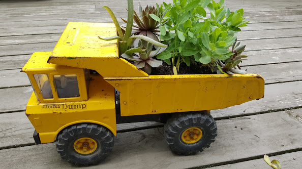 Using a Tonka truck as a unique flower planter