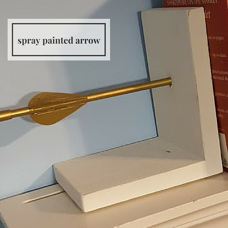 golden arrow bookends spray painted arrow
