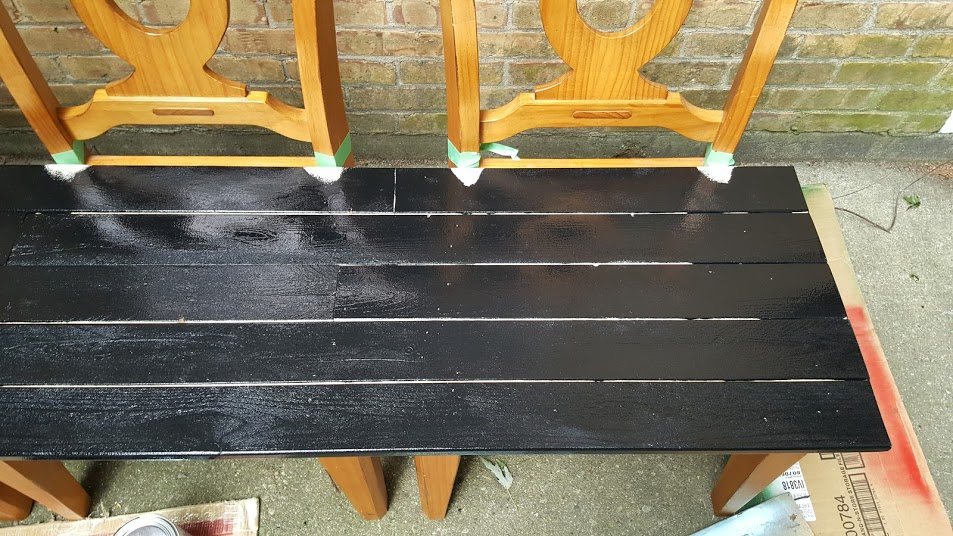 Added to coats of flat black paint to the chair bench