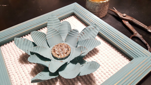 3 tin cans made into a painted metal flower