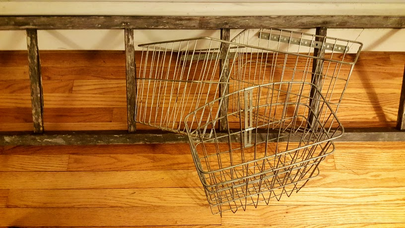 Before pic of rustic ladder and vintage wire baskets