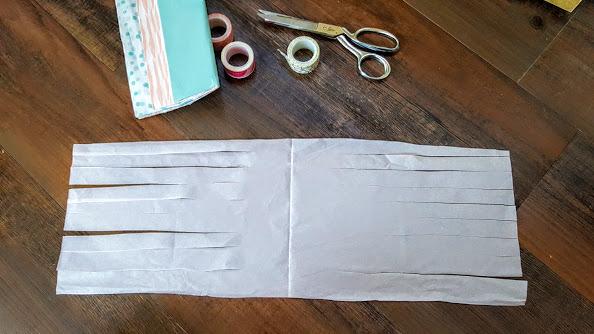 cutting tissue paper tassel garland