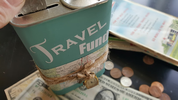 Travel fund coin bank filled with money for vacation