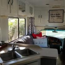 glamper living room makeover with map art sign