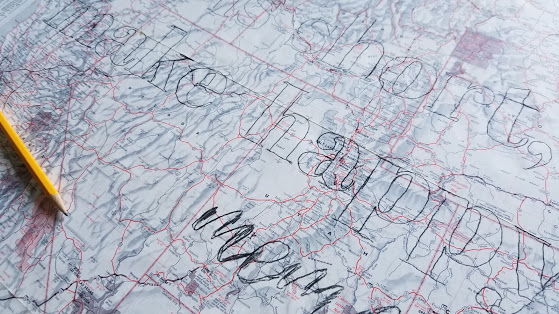 map art sign with outlined words