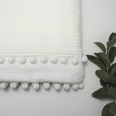 Inexpensive fall home decor - Etsy - White Pom Pom blanket